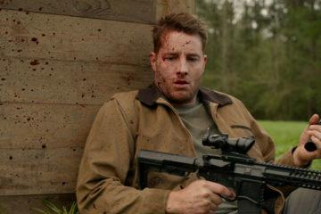 The Hunt 2020 Movie Dean J. West Hiding with guns