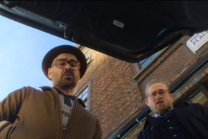 The Gentlemen 2019 Movie Review Charlie Hunnam as Ray and Colin Farrell as Coach looking at trunk of a car