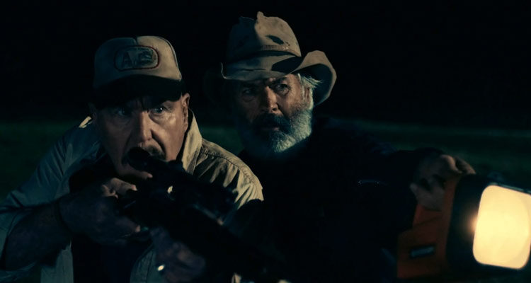 Boar 2017 Movie John Jarratt and Roger Ward with a rifle aiming at the monster boar scene