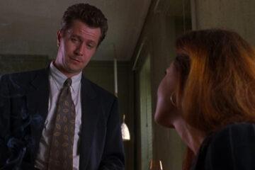 Romeo Is Bleeding 1993 Movie Gary Oldman looking at Lena Olin as she's smoking a cigarette scene