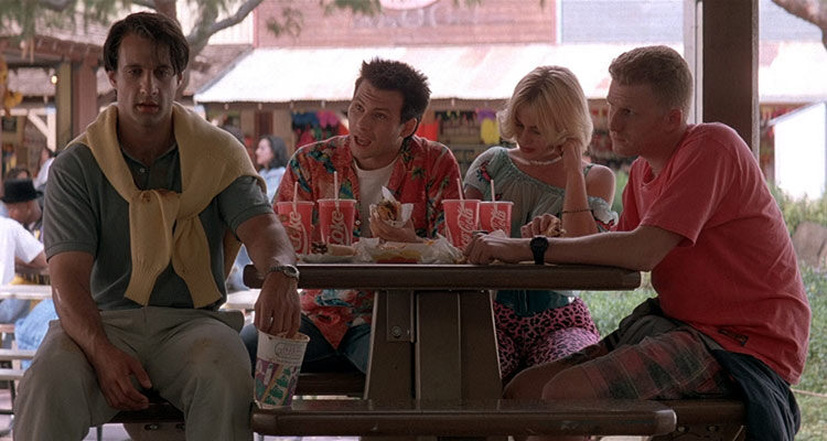 True Romance 1993 Movie Christian Slater, Patricia Arquette, Michael Rapaport and Bronson Pinchot seating at a table after a roller-coaster ride scene