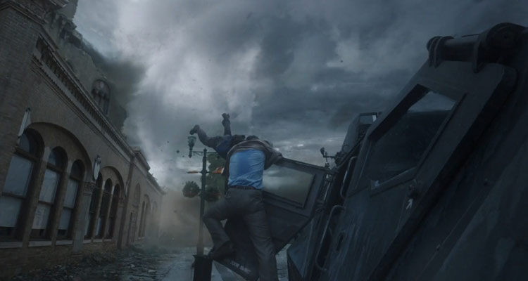 Into The Storm 2014 Movie Richard Armitage as Gary trying to save Sarah Wayne Callies as Allison as she's barely hanging on to a door of a tornado vehicle while being pulled towards tornado