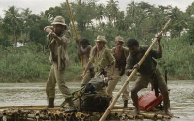 The Mountain of the Cannibal God 1978 Movie Ursula Andress, Stacy Keach and the rest of the crew on a raft trying to shoot a crocodile that just attacked them