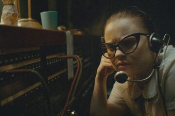 The Vast of the Night 2019 Movie Sierra McCormick as Fay Crocker in switchboard room listening to strange signal coming from the telephone line