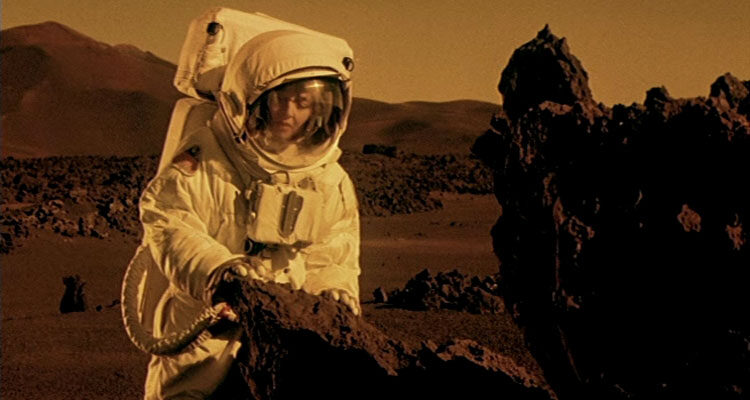 Stranded 2001 Movie Maria de Medeiros in spacesuit walking on the surface of Mars