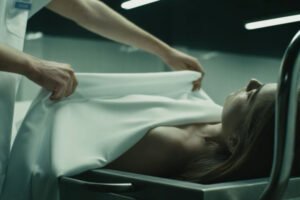 The Corpse of Anna Fritz 2015 Movie Albert Carbó pulling the sheets to reveal the dead body on the tray