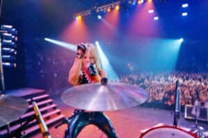 The Dirt 2019 Movie Daniel Webber as Vince Neil on stage singing as we follow the show from Tommy Lee's perspective or point of view