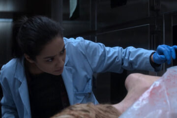 The Possession of Hannah Grace 2018 Movie Shay Mitchell looking at the corpse of Hanna in the morgue