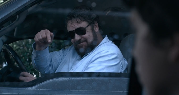 Unhinged 2020 Movie Russell Crowe pointing his finger instructing Caren Pistorius to roll her windows down