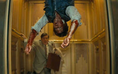 Down 2001 Movie Edward Herrmann in an elevator looking at a bloody dead body hanging upside down
