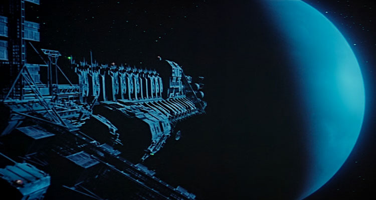Moon 44 1990 Movie Giant transport vessel or spaceship getting close to the blue moon