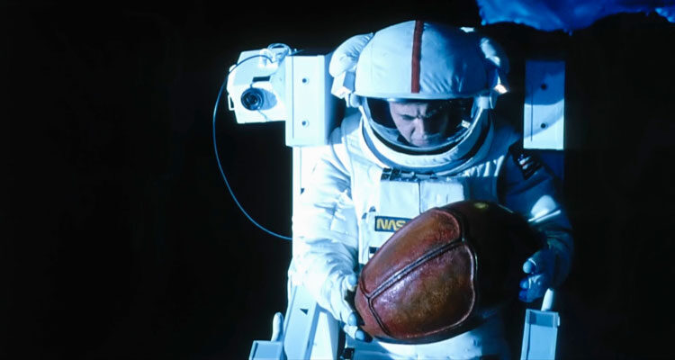 Moontrap 1989 Movie Walter Koenig in space suit holding a strange object that resembles an egg that he just retrieved from a derelict ship