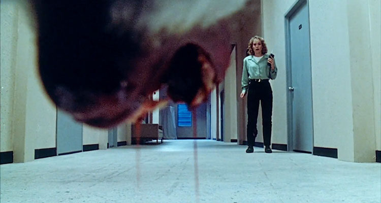 Shakma 1990 Movie Jaws of a killer baboon open dripping with blood as Amanda Wyss is standing in the hallway