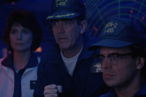 The Rift 1990 Movie R. Lee Ermey, Ray Wise and Deborah Adair looking at the progress of others on a submarine screen