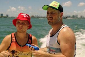 Miami Bici 2020 Movie Matei Dima and Codin Maticiuc on a boat putting on sunscreen