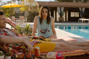 Palm Springs 2020 Movie Andy Samberg and Cristin Milioti sitting by the pool and drinking beer