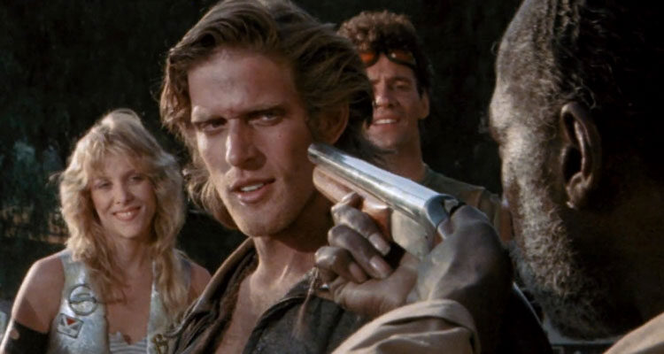 Parasite 1982 Movie Luca Bercovici as the leader of the gang trying to charm bar owner holding a gun to his head