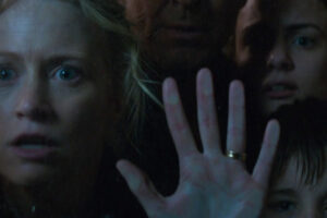 The Pack 2015 Movie Anna Lise Phillips holding her hand on a window with Jack Campbell, Katie Moore and Hamish Phillips standing beside her