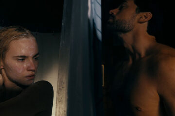 What Lies Below 2020 Movie Ema Horvath in the shower while inches away from her is Trey Tucker smelling her