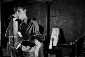 Control 2007 Movie Sam Riley as Ian Curtis singing in a studio