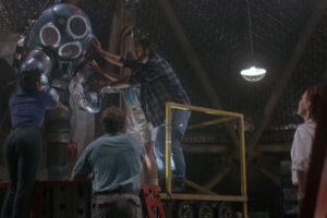 DeepStar Six 1989 Movie The crew helping Matt McCoy as Richardson out of this huge diving suit