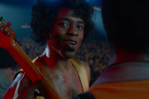 Get on Up 2014 Movie Chadwick Boseman as James Brown in a golden onesie talking to the camera