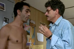 L627 1992 Movie Didier Bezace as Lulu holding a bag of powdery substance, most likely heroin, in front of a naked suspect