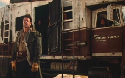 Neon City 1991 Movie Lyle Alzado as bulk standing in front of the bus holding a gun