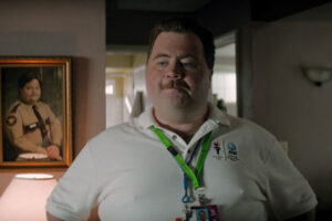 Richard Jewell 2019 Movie Paul Walter Hauser dressed in a security guard shirt with his pass
