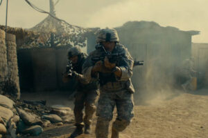 The Outpost 2020 Movie Scott Eastwood as SSG Clint Romesha charging towards the camera