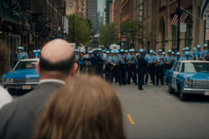 The Trial of the Chicago 7 2020 Movie Police forces lining up in front of the police station where Eddie Redmayne as Tom Hayden is being held