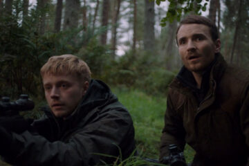 Calibre 2018 Movie Jack Lowden holding a sniper rifle and Martin McCann watching in horror
