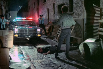 Fear City 1984 movie Tom Berenger with his hands up