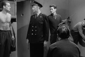 Le Trou 1960 Movie Philippe Leroy, Raymond Meunier, Marc Michel and Jean Keraudy with his back to us during a cell inspection