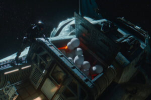 Space Sweepers 2021 Movie One of the crew opening a ship's cargo hold and releasing a bunch of white balls