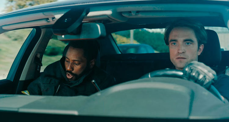 Tenet 2020 Movie John David Washington and Robert Pattinson in a car driving down the highway
