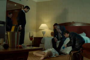 The Nile Hilton Incident 2017 Movie Fares Fares as Police Commander Noredin Mostafa looking at the body of a dead woman in the hotel