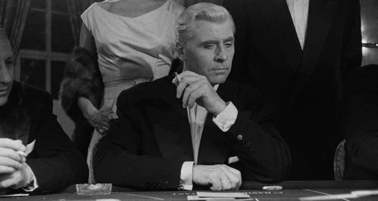 Bob Le Flambeur 1956 Movie Roger Duchesne as Robert 'Bob' Montagné gambling in a casino and smoking a cigarette