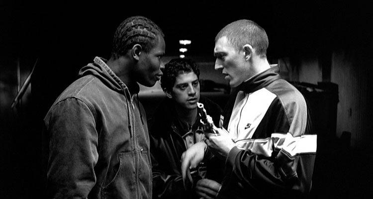 La Haine 1995 Movie Vincent Cassel as Vinz holding a gun next to Hubert Koundé and Saïd Taghmaoui