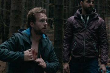 The Ritual 2017 Movie Rafe Spall showing wounds on his chest in the forest