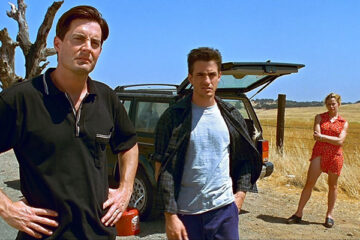 The Trigger Effect 1996 Movie Kyle MacLachlan, Elisabeth Shue and Dermot Mulroney on the road next to their car