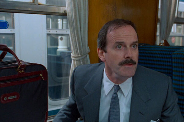 Clockwise 1986 Movie John Cleese realizing he's in a wrong train