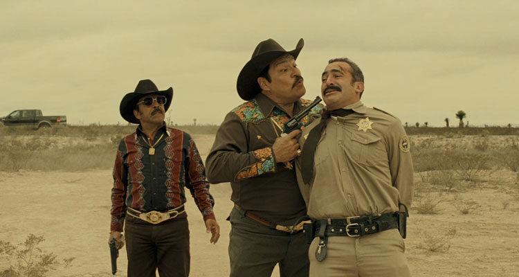 El Infierno 2010 Movie Damián Alcázar and Joaquín Cosio holding a gun to a policeman's face