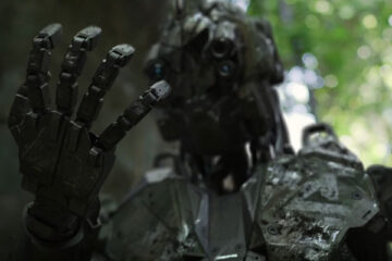 Monsters of Man 2020 Movie Killer robot BR4 looking at his hand