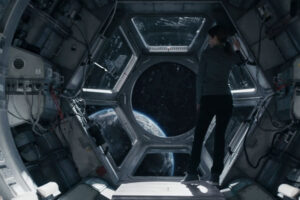 Stowaway 2021 Movie Anna Kendrick as Zoe Levenson looking at Earth from space