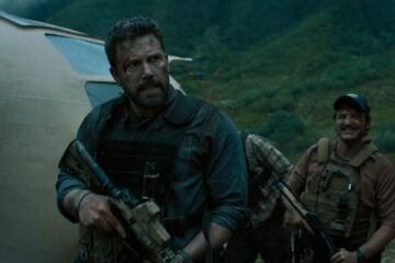 Triple Frontier 2019 Movie Ben Affleck as Tom Redfly Davis and Pedro Pascal as Francisco Catfish Morales standing with guns