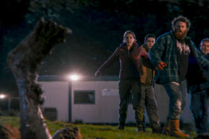 Boys From County Hell 2021 Movie Michael Hough, Louisa Harland, Nigel O'Neill and Jack Rowan retreating in terror as Abhartach's foot emerges from the ground