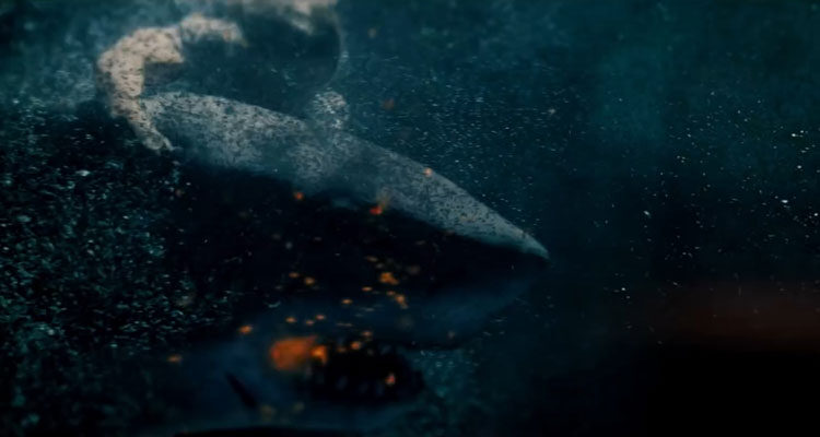 Great White 2021 Movie News Scene A shark swimming with a flare in its mouth as a person is holding on to it