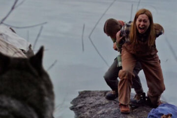 Hunter Hunter 2020 Movie Scene Camille Sullivan and Summer H. Howell standing near the river and screaming at the wolf