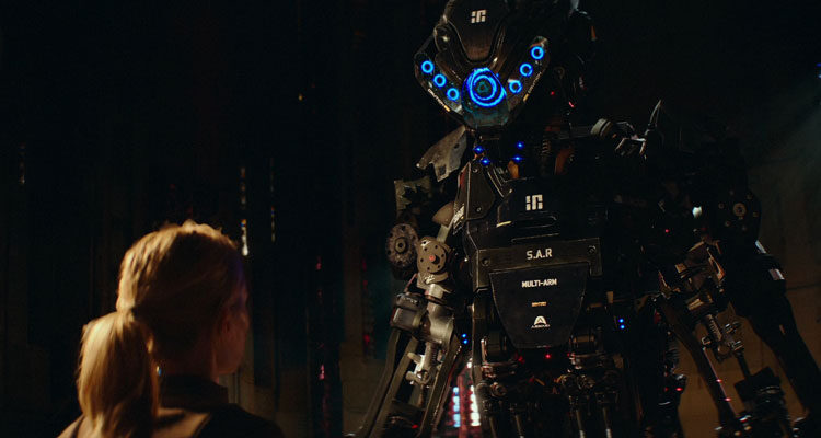 Kill Command 2016 Movie Scene Vanessa Kirby as Mills looking at a giant SAR killer robot